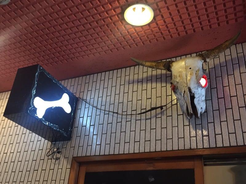 一条流がんこラーメン 総本家 四谷三丁目 看板 牛の頭 仮面